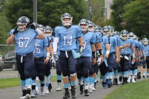 Columbia football players walk to field