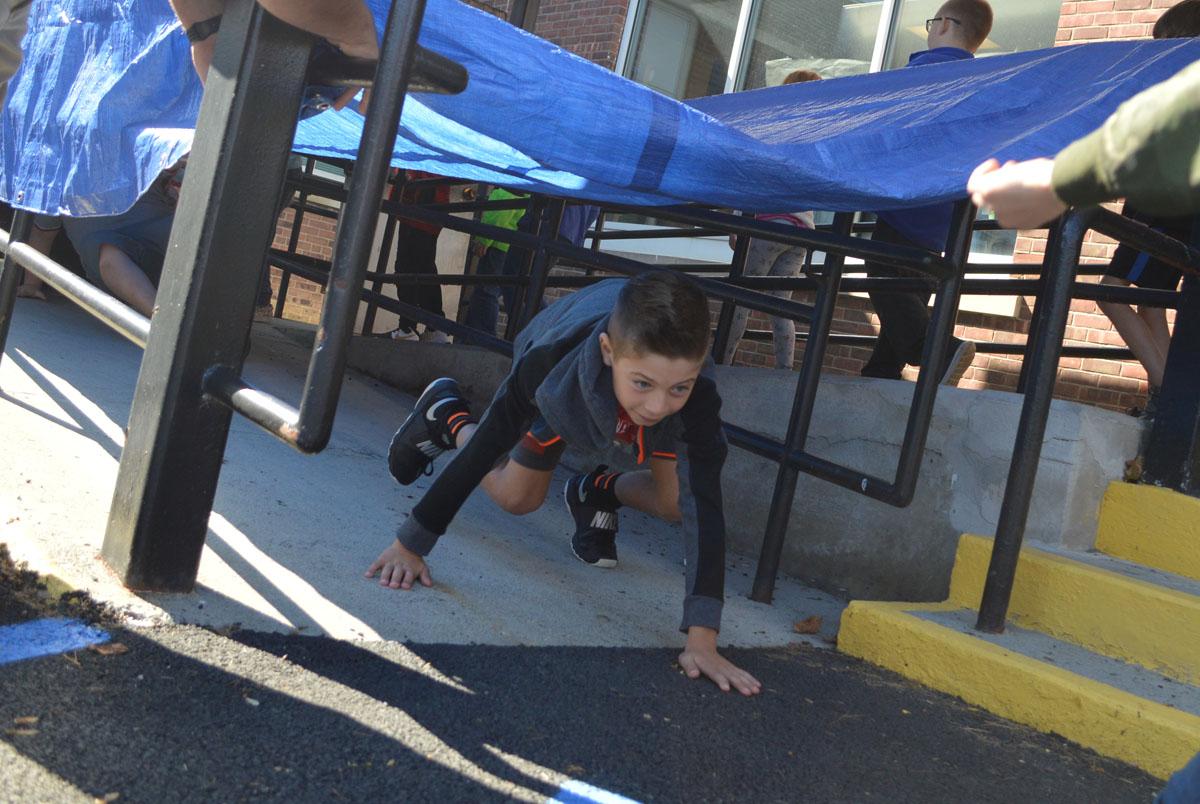 Student crawls through tunnel