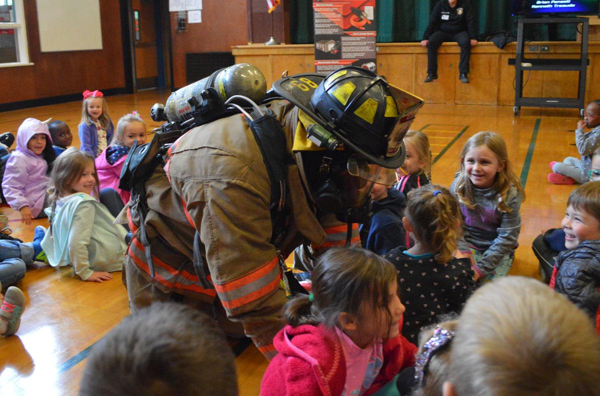 Firefighter crawls on floor