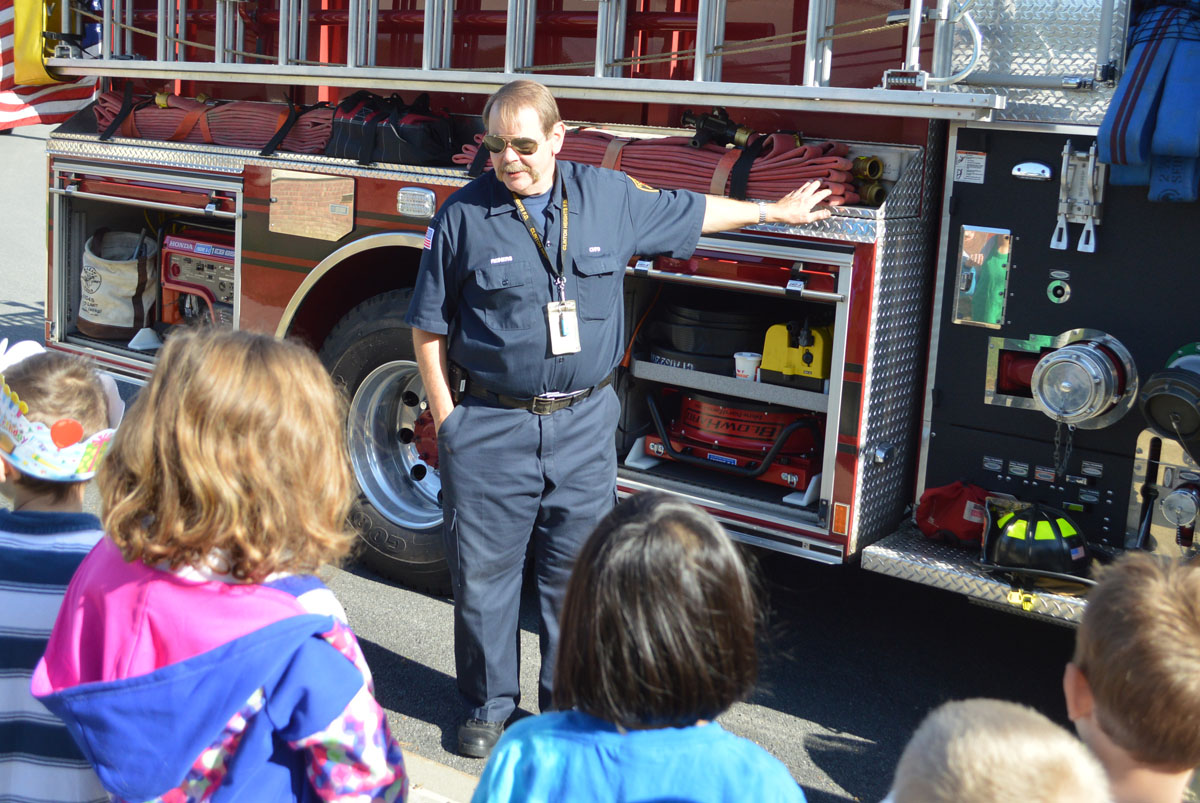 Firefighter talks to students