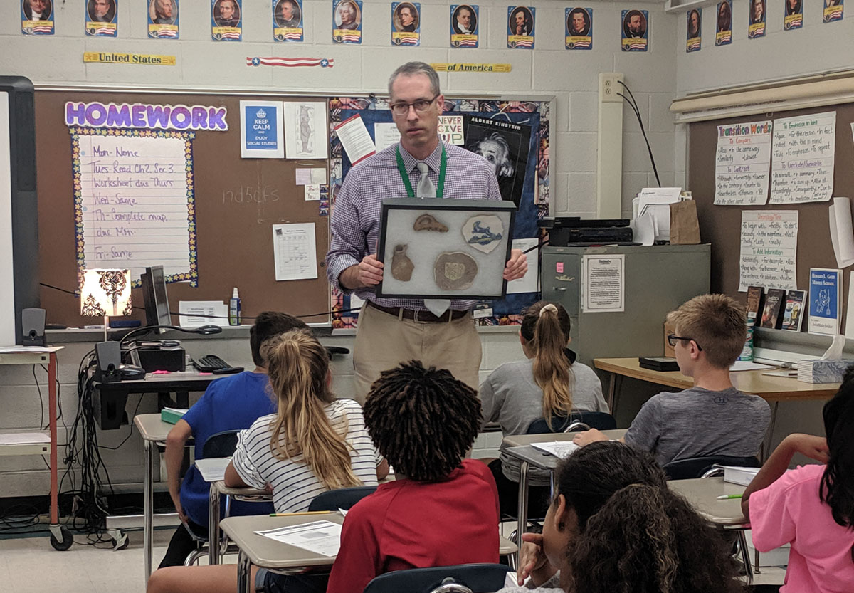 Historian from the NYS Museum shows students 3-D artifacts from Fort Orange