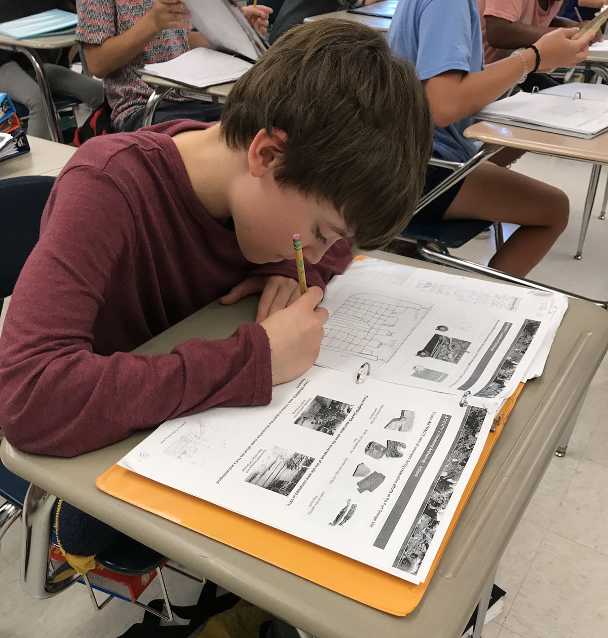 Student completes worksheet in class