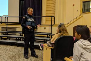 Officer Abraham talking with students at Genet Elementary School