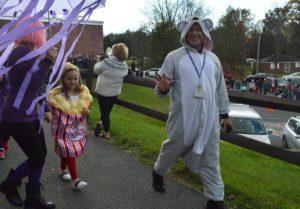 Principal Mahar walking in Bell Top's 2017 Halloween Parade