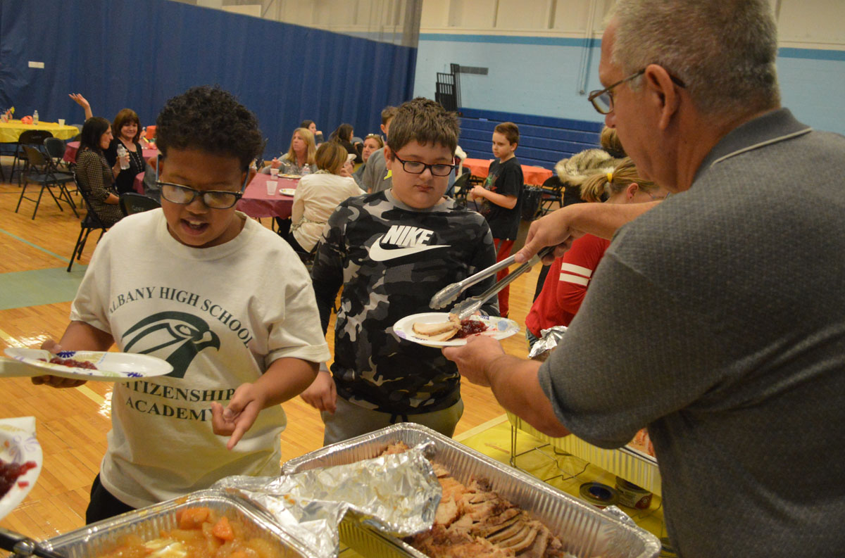 Steve Taylor serves students at Goff Middle School's annual Thanksgiving Feast
