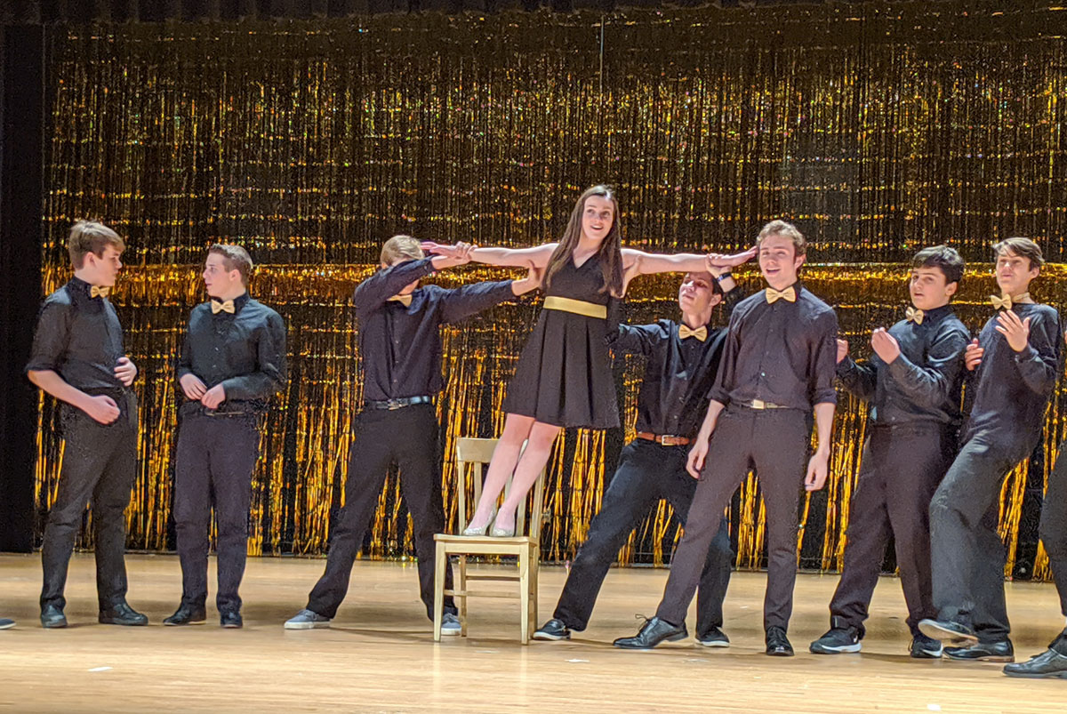 Cast from Once Upon a Stage performs on stage at Columbia High School