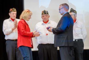 Debra Weichold receives American flag at Veterans Day ceremony
