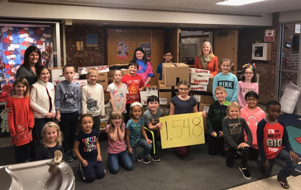Students present Equinox Thanksgiving Dinner donation