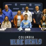 Columbia student athletes with their parents at signing ceremony