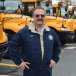 Mark Noeth in school bus parking lot