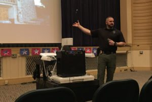 Police officer leads active shooter safety presentation