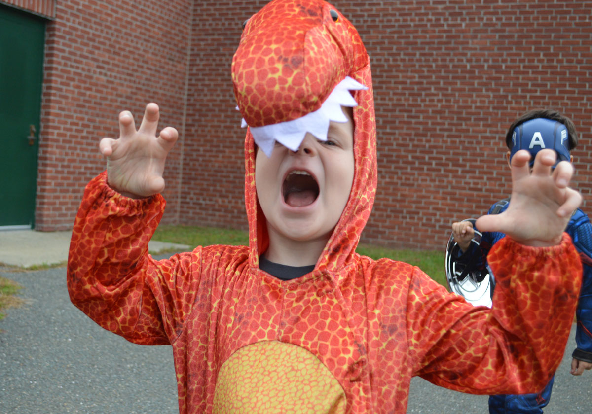 Student dressed as a dinosaur for Halloween