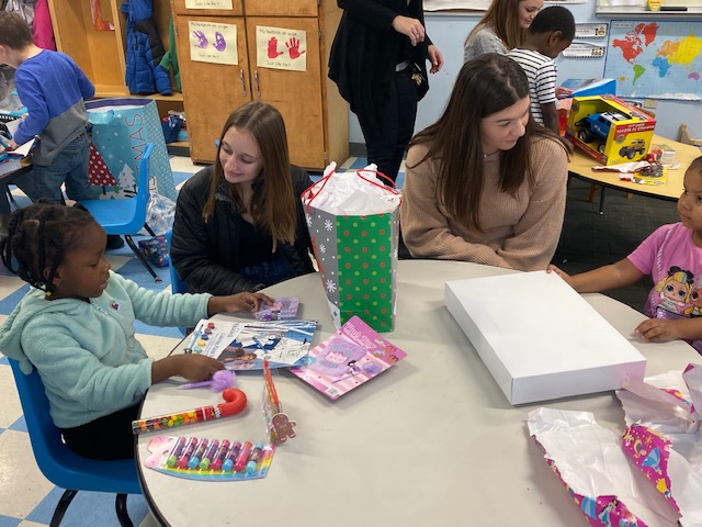 Columbia students visiting with St. Anne's Institute preschool students