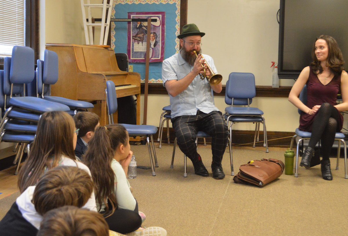 Kirk Knuffke plays the cornet for students at DPS