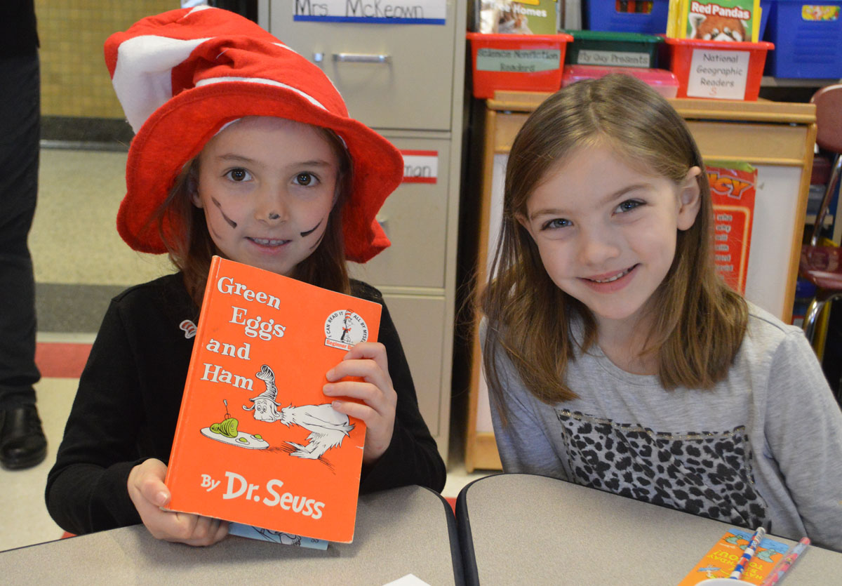 Students reading the book Green Eggs and Ham