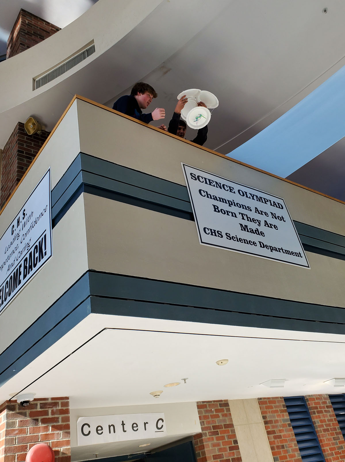 Students drop an egg from the lobby balcony
