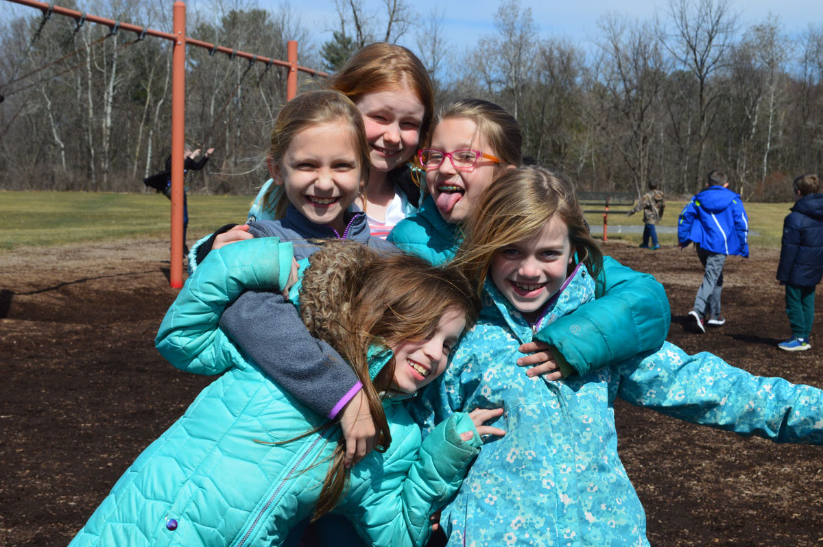 Genet students on playground in April