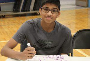 Aidan Singh writing answers at Geography Bee