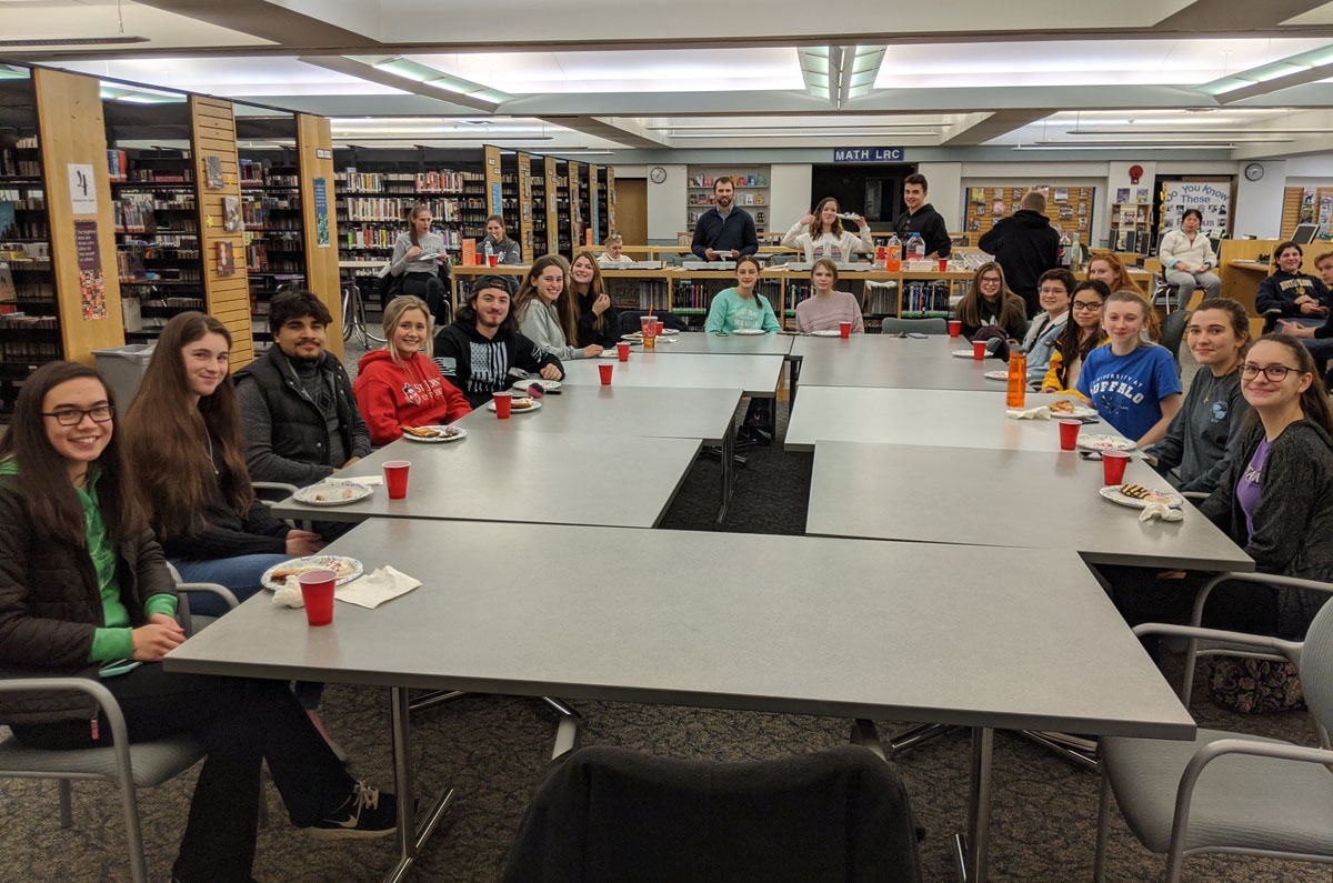 Students at Dinner with a Scientist in CHS library