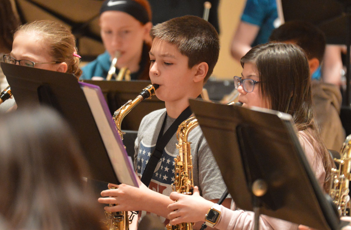 Student playing saxophone at 2020 Instrumental Festival