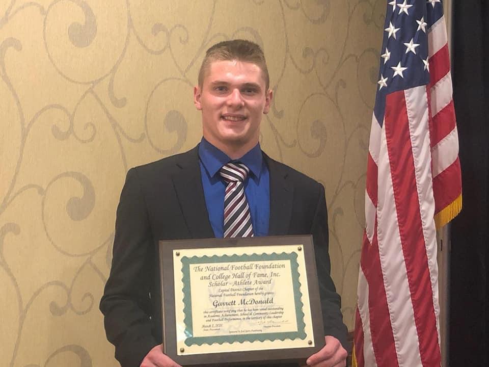 Garrett McDonald receives award