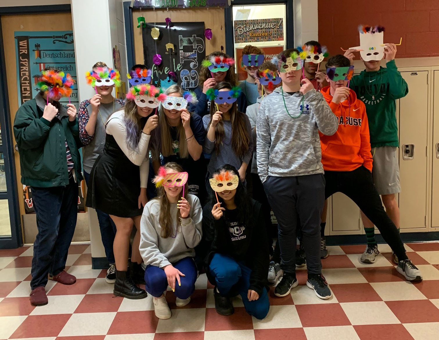 French students wearing Mardi Gras masks