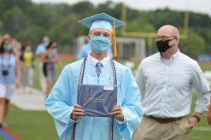 Kason Romanowski holding diploma