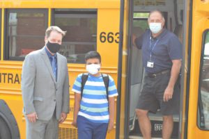 Jeff Simons with student and bus driver