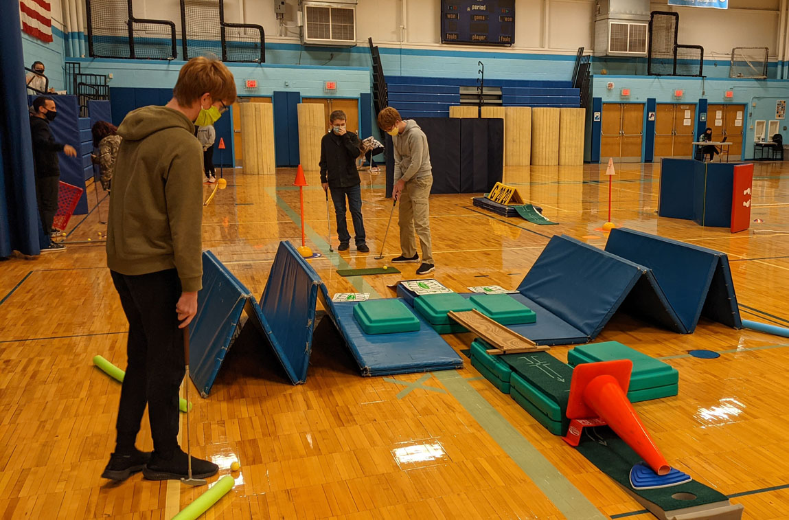Goff students playing mini golf in the school gym