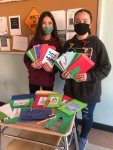 Goff students holding holiday cards