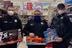 Police officers shopping for Christmas presents to benefit families in need