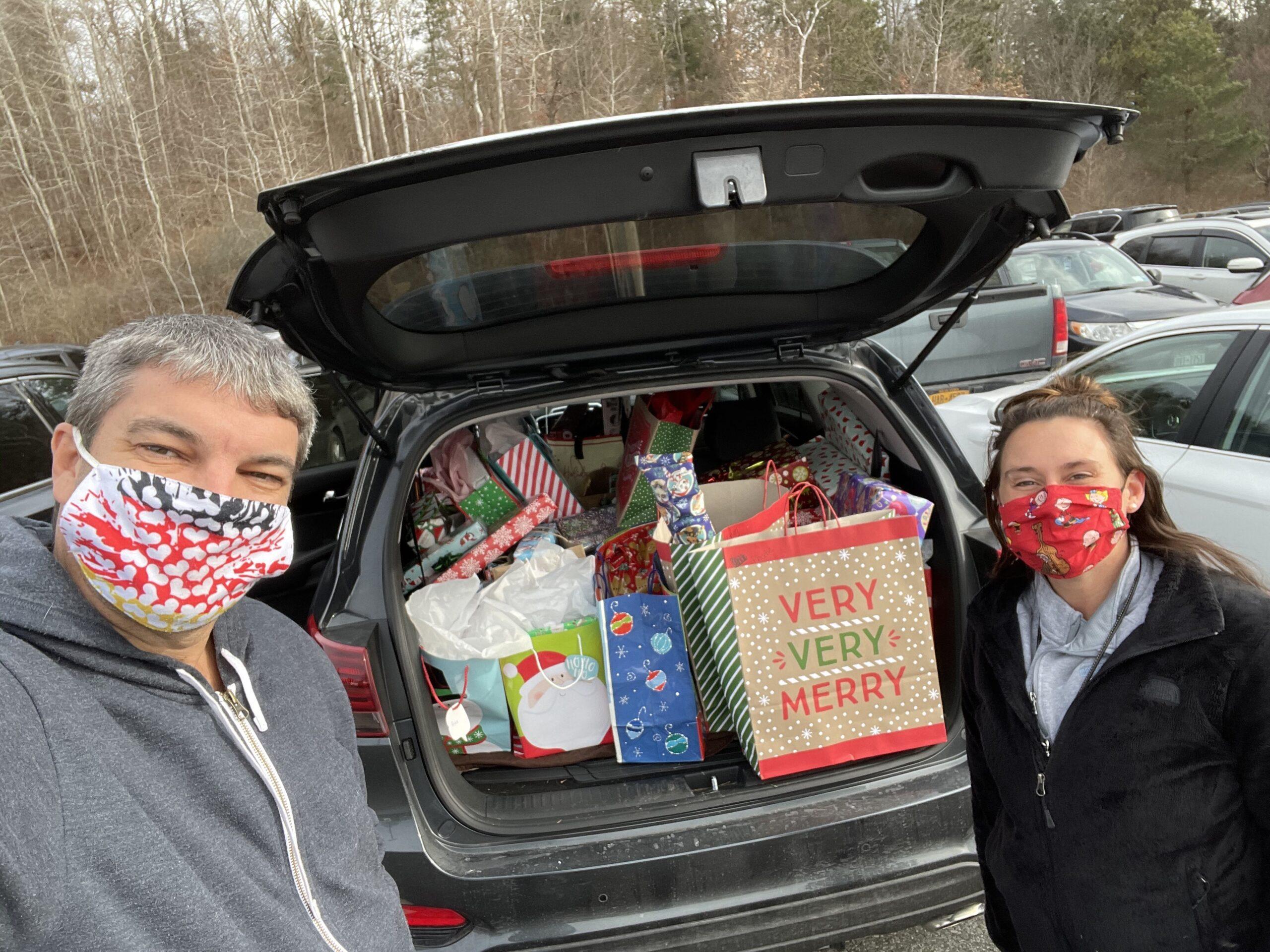 Rune Williams and Christine Kawczak deliver presents