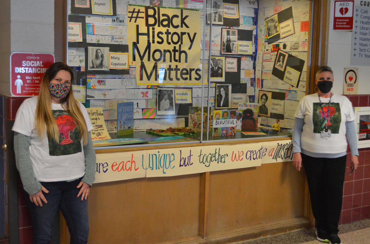 Mrs. Mathis and Mrs. Anderson-Green in front of Black History Month display case.