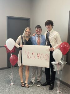 Taylor O'Brien, Ryan Blake and Chase Durivage celebrate fundraiser total