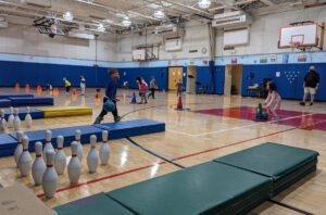 Red Mill kindergarten students bowling in PE class