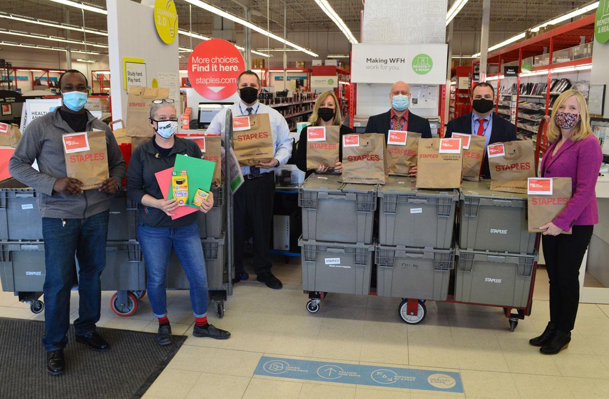 Principals Wayne Grignon, Marty Mahar, Jill Barker, Daniel Garab and Helen Squillace receive a school supply donation from Staples