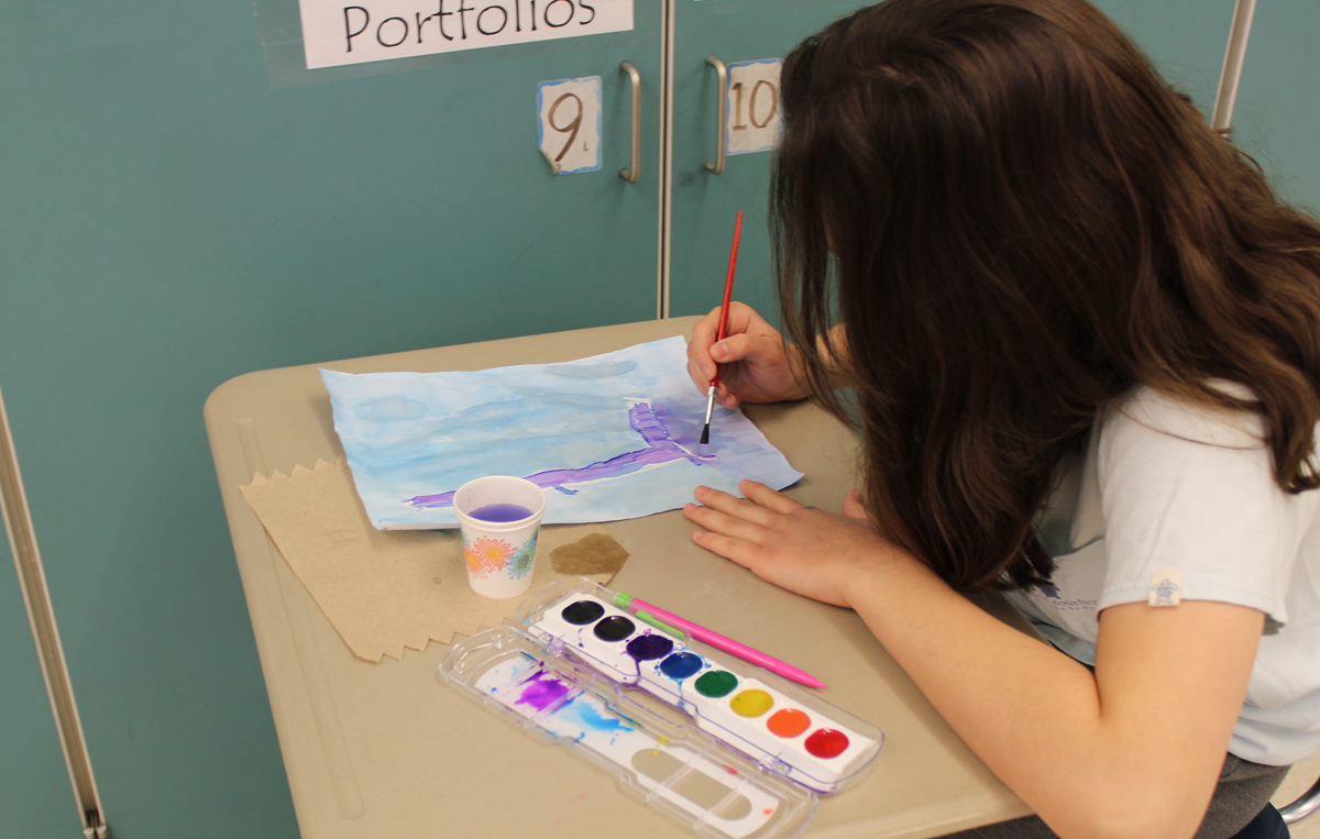 Student painting with watercolors
