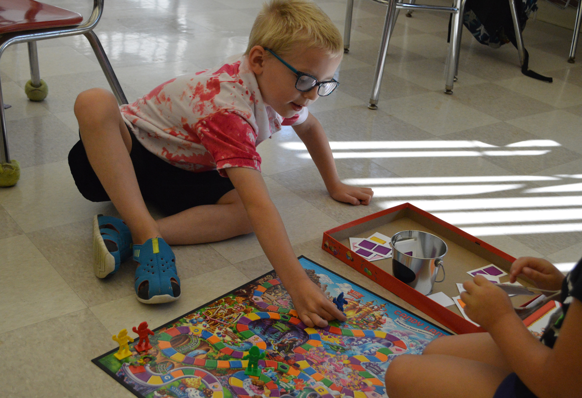 Student playing Candyland